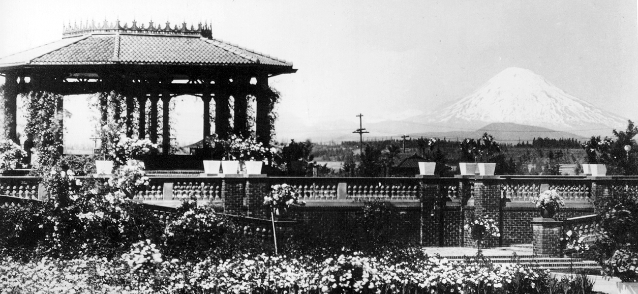 Historical black and white photograph of octagonal bandstand in the middle of the rose garden.