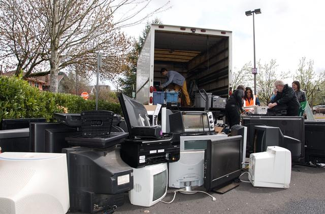 TVs and monitors being loaded into truck