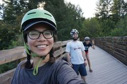 Corrine in bike helmet and glasses smiling