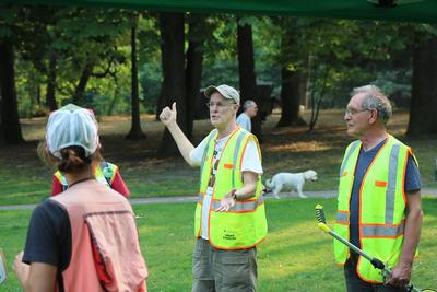 Volunteer Jim Keiter provides commentary at the beginning of an inventory workday