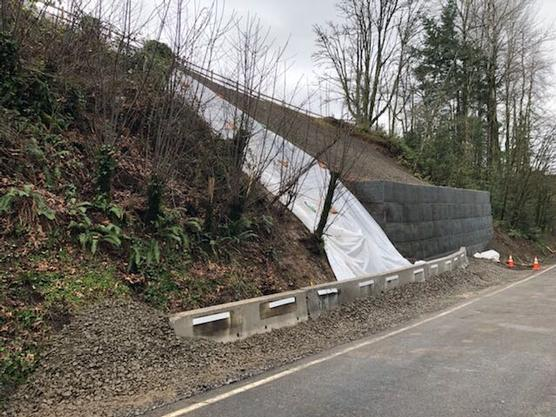 Tarp and Jersey barriers cover landslide area