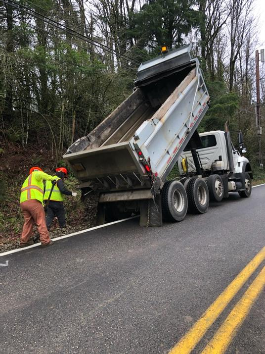 Crews use dump truck to make shoulder safe