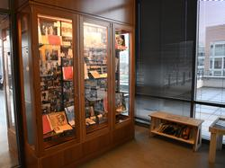 View of the exhibit case with photos of women