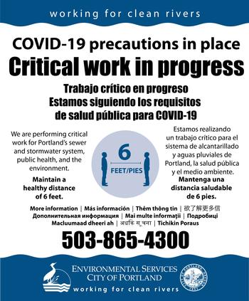 Construction sign with covid-19 precautions - maintain 6 feet distance