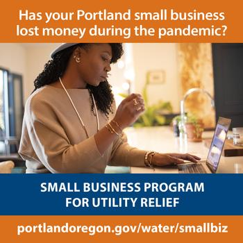 Image: Black woman at desk - has your Portland business lost money during COVID-19, we may be able to help