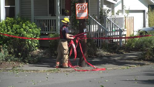 firefighter with emergency tape